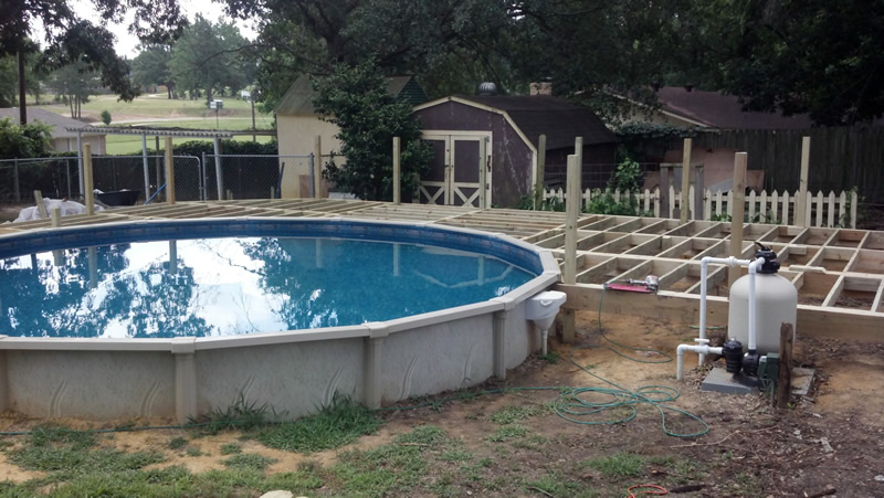 Custom wooden deck thompson builders for Luxury above ground pools