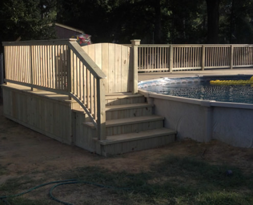Hide your above ground pool with a custom wood deck and turn your backyard into a luxury outdoor living space.