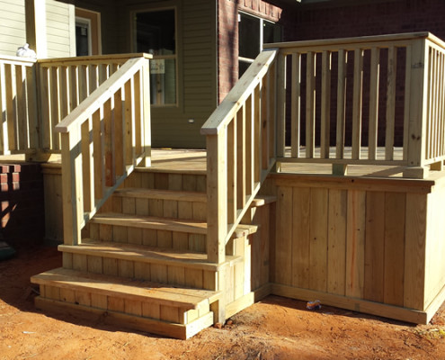 Wood decks add additional outdoor living space to a new custom built home.