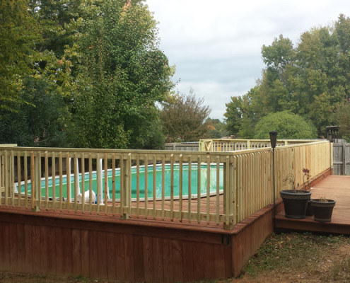 Outdoor Living Space - Wrap around wood deck for above ground pool